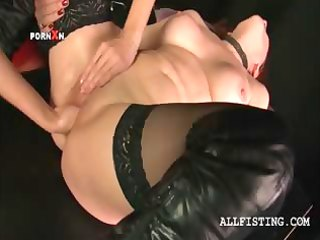 lesbian aged in nylons receives fist drilled