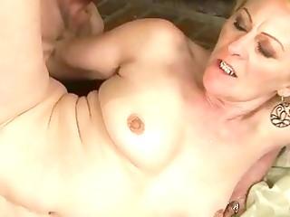granny enjoys naughty sex with a boy