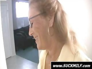 mommy wearing glasses gives this young man a