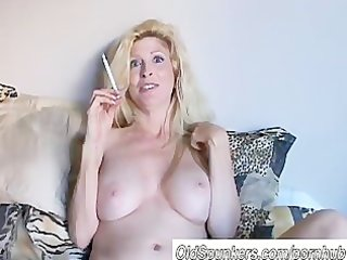 pretty golden-haired milf enjoys a smoke break