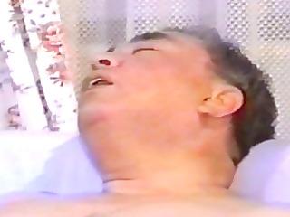 oriental aged chap masturbates on sofa
