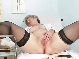 busty granny in uniform stretching her mature