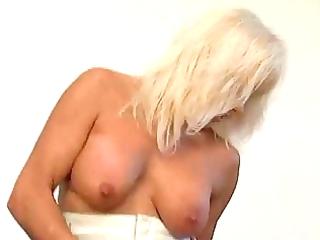 pierced blond milf in nylons fucks the window