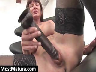 with a big darksome sex toy a youthful brunette