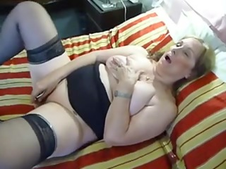 Older Plump dildoing on couch