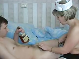 aged doctor is engulfing a pounder of her pacient
