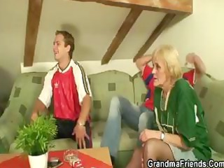 she is a aged blond who invites a pair of lads to