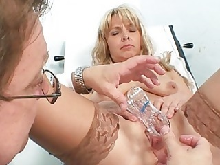 aged blond vixen in stockings goes to gyno exam