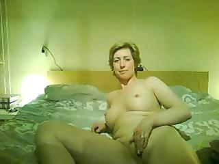 older short-haired blond performs for the webcam