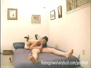 flat chested oriental wife strikes a 102 pose