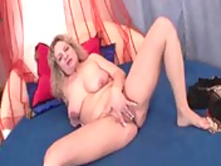lascivious mature playgirl engulfing sex toy and