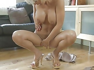 fleshly blond momma with large wobblers in heels