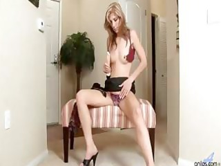 older golden-haired uses a vibrating sex-toy and