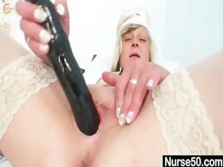 bawdy nurse milf nada copulates herself with