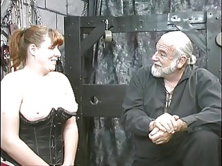 Young bdsm slave girl brunette in corset is